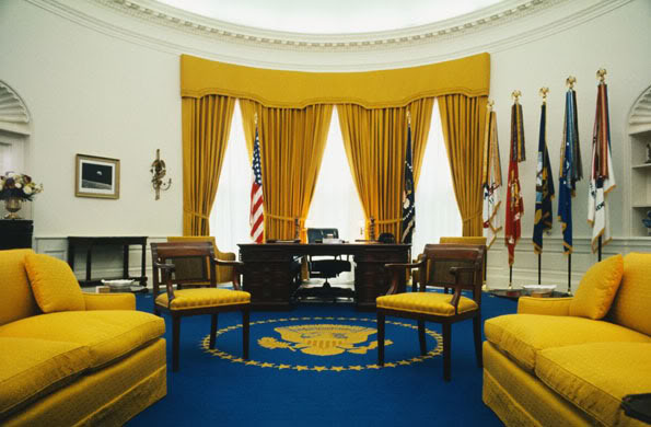 1902, Washington, DC, USA --- Washington, D.C.: View of President Richard Nixon's office in the White House. The rug, designed by Mrs. Nixon, features the Presidential seal in gold in the center and golden stars around the edge, all on a field of flag blue. --- Image by Bettmann/CORBIS American (period or style) Beauty Government Mid-Atlantic Neoclassical (period or style) Nobody North America North American (period or style) Office Oval Office Political leaders Prominent persons Room USA Visual arts Washington, DC West Wing White House